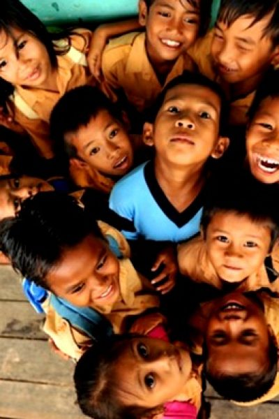Photo of Indonesian Children being happy in a group. This image was sourced from: https://indonesiadigitalgeneration.wordpress.com/2016/04/28/36/
